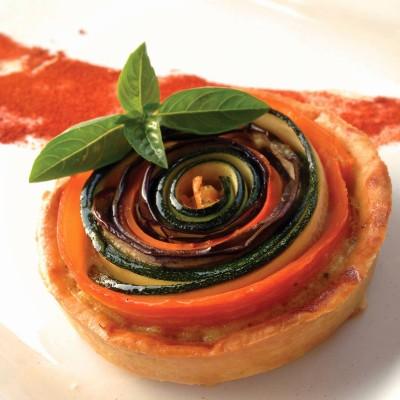 Tarte spirale aux légumes - Cette entrée festive peut être accompagnée d'une salade verte.