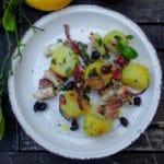 Salade de poulpe de roche - Dresser harmonieusement la salade dans les assiettes.